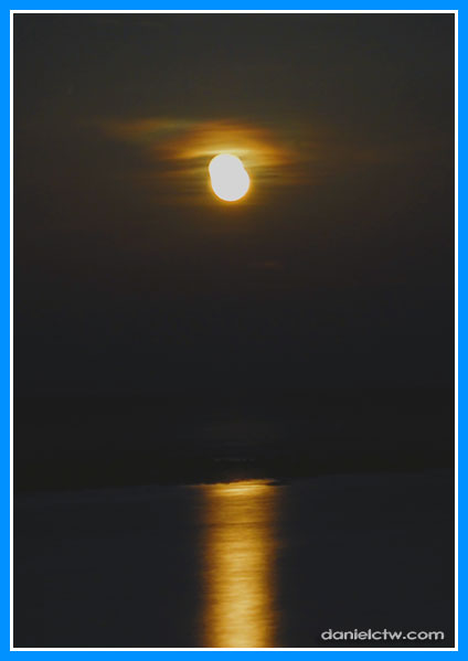 Orange Moon Over Sea