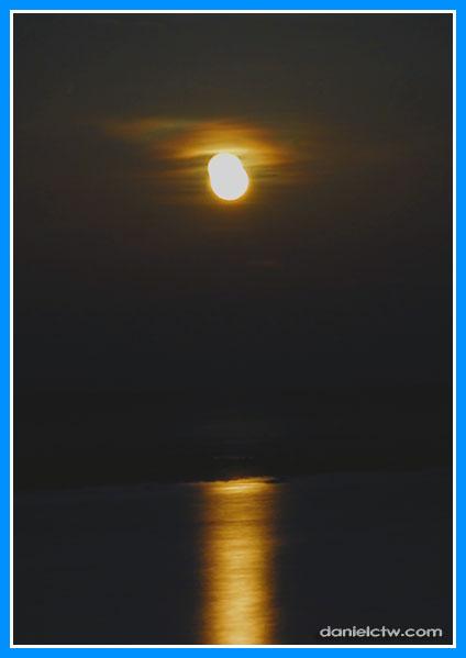 Orange Moon Over Sea