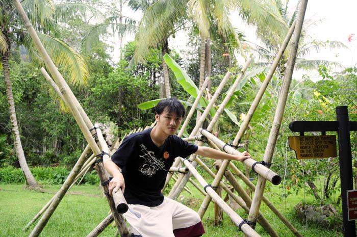 Daniel Chew on bamboo bridge