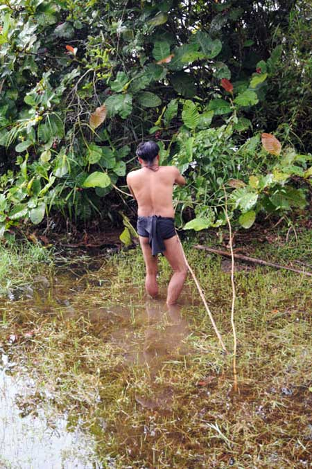 Penan Man in the water
