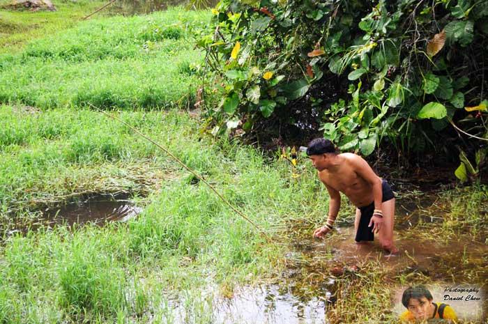 Penan Man Checking for Fish