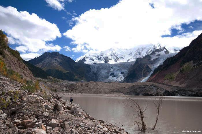 Human with Midui Glacier