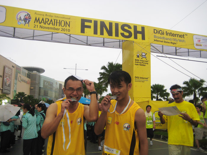 Biting the PBIM 2010 Finisher Medal